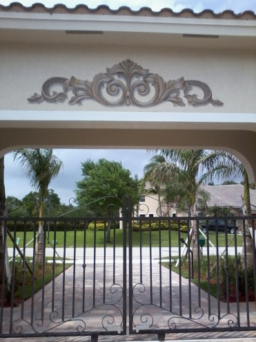 Bas relief design painted over driveway