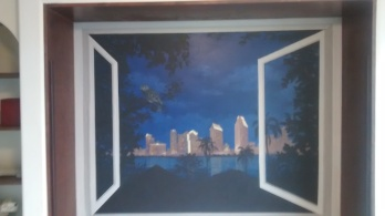 A trompe l'oeil featuring San Diego by night.