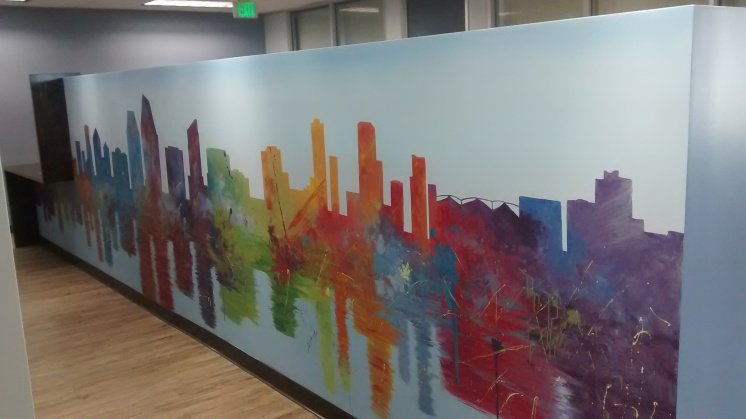 This law office wanted a lively and abstract version of the San Diego skyline stretched out across 20' of this dividing wall.