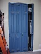 Closet doors painted like sports lockers