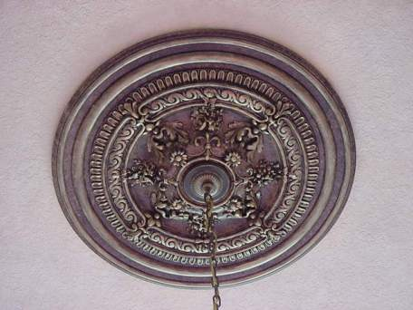 Faux finished bronze and gold ceiling medallion