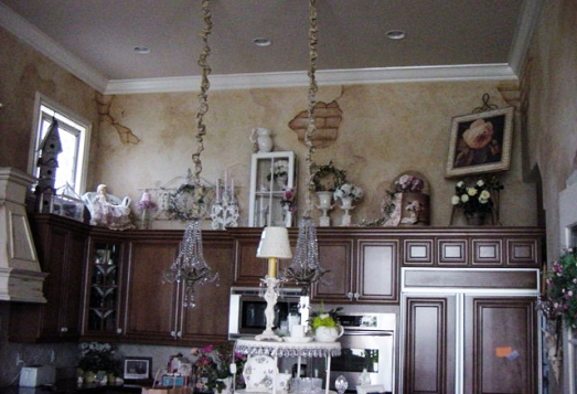 French country style kitchen, with faux peeling plaster revealing bricks underneath