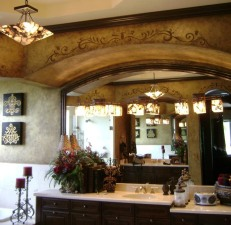 This rich bronze faux finish was aged before hand painted acanthus designs were added
