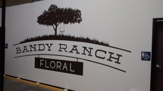 Large logo at this floral distributor in Rancho Penasquitos - https://www.bandyranchfloral.com/