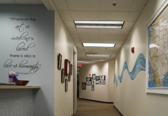 A winding wave and inspirational phrase inside an office lobby