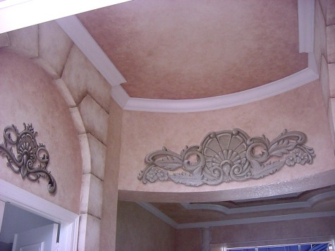 Trompe l'oeil accents over softly faux finished walls and ceiling