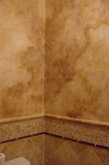 Tuscan style walls that resemble travertine