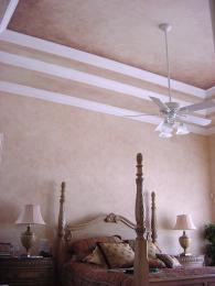 Soft faux finished walls and ceiling make this bedroom cozy