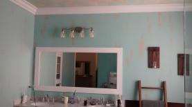 Modern chic bathroom with tastefully aged walls
