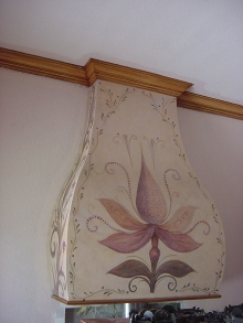 Artistic touch over a fireplace mantle and wood grained crown molding