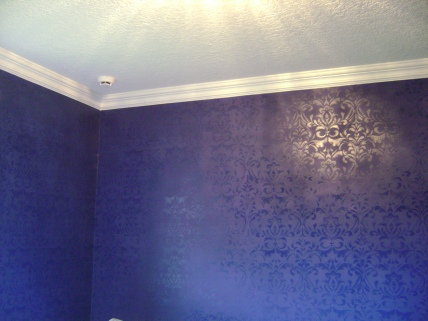 Electric blue damask stencil in a guest bedroom