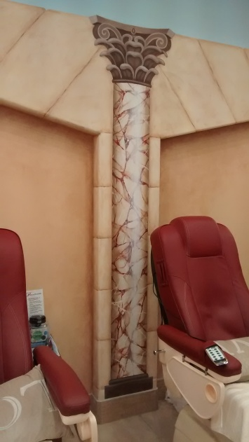 Trompe l'oeil marble columns and faux finish stones in a nail salon