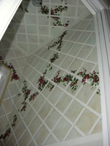 3-dimensional lattice and ivy over a soft faux finish