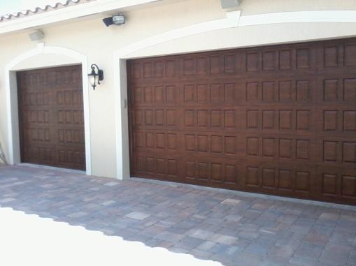 Wood-grained metal garage doors