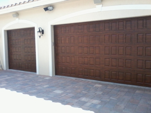 Wood-grained metal garage doors