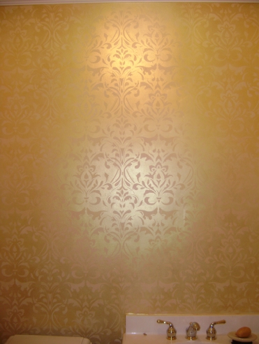 Classic gold damask stencil in a guest bathroom