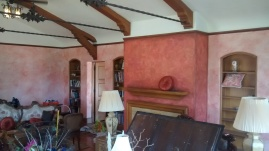 Wood grain beams and old-world faux finished living room