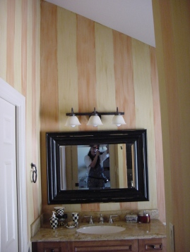 Color-washed Mackensie Childs theme walls in a powder room