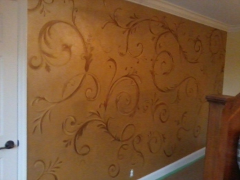 A delicate hand-painted acanthus design on an accent wall