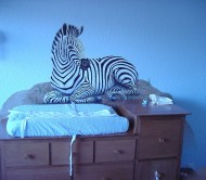 Zebra mural over a changing table
