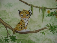 Baby tiger in a baby room
