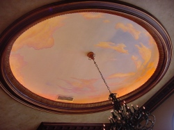 Beautiful sunset mural on a living room tray ceiling