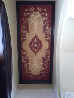 Dramatic entryway red and gold ceiling
