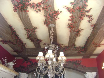 Trompe l'oeil wood beams and bougainvillea on a dining room ceiling