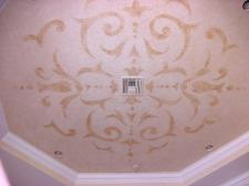 Large acanthus design on a family room ceiling