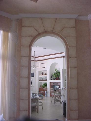 Faux stones accent a grand archway