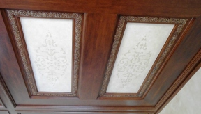 Wood-grained panels and subtle faux finish design panels