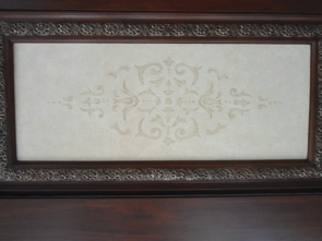Soft hand-painted design on one of 16 wood-grained ceilng panels