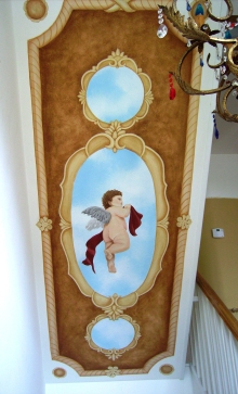 Classic romanesque cherub ceiling design over a staircase