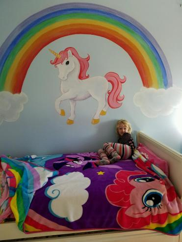 Unicorns and rainbows in a girl's room