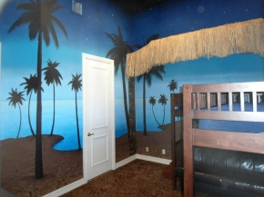 Night time beach mural in a kid's room