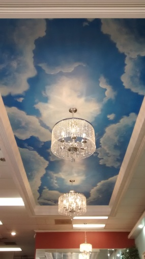 Ceiling clouds mural at a beauty salon