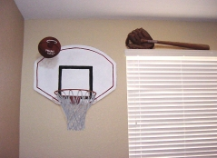 Basketball and baseball trompe l'oeil in a kid's room