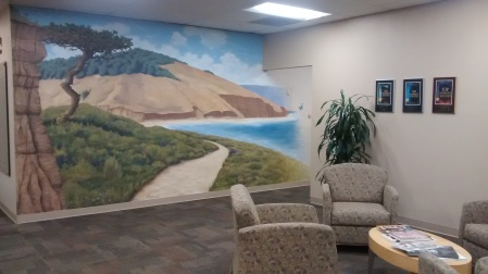 An idyllic image of Torrey Pines creates a calm ambiance in this San Diego office - https://jcfsandiego.org/