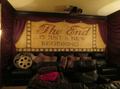 Faux drapes and movie reel inside a home theater