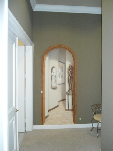 A doorway opens up this space, leading into a hallway