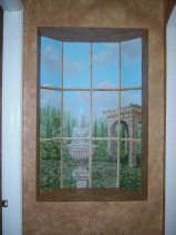 Hallway niche opens up with this trompe l'oeil window