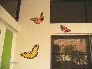 Realistic butterflies greet visitors by this entryway