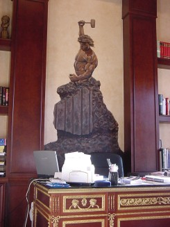A painted bronze statute in an office