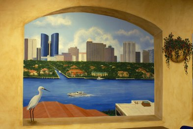 Trompe l'oeil window overlooks a city skyline