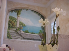 An elegant arched window mural shows Lake Como