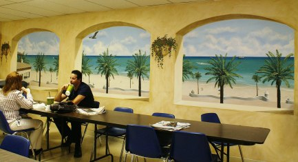 Trompe l'oeil mural looking out at the ocean in this office cafeteria - https://www.amerijet.com/