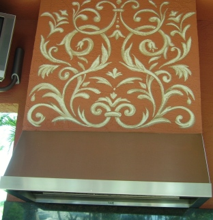 Warm colors and design decorate this Patio mantle