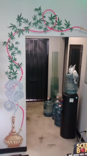 Vape shop wall behind cashier